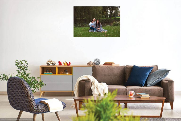 A livingroom with a beautiful family picture on the wall